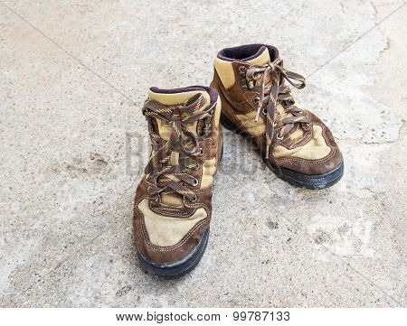 Brown Hiking Boots On The Floor