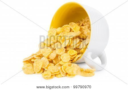 Inverted Cup With Corn Flakes Isolated On White