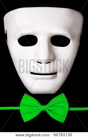 white mask and green bowtie