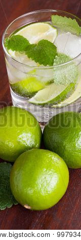 Mohito Cocktail Surrounded By Limes