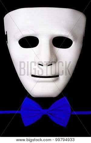 white mask and blue bowtie