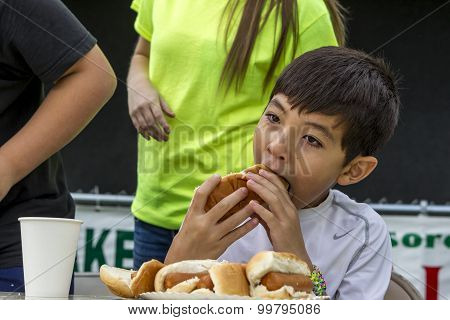 Biting Into The Hot Dog.