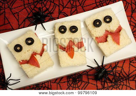 Halloween monster sandwiches with spiderweb background