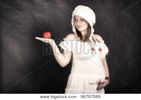 Redhead beauty with an apple in her hand