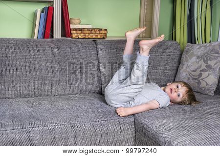 Little Kid Hanging Around On The Couch