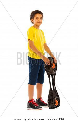 African black boy standing with skate board