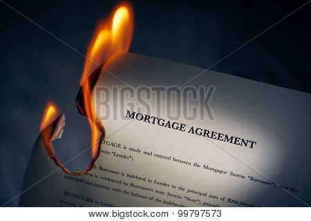 Mortgage Agreement Contract Burning On Fire