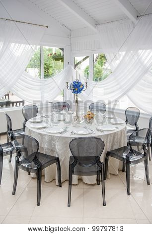 Wedding table setting. Table set for an event party or wedding reception. Elegant table setting
