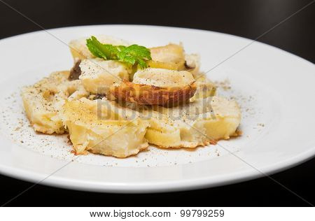 Dish Of Italian Swivels Pasta With Porcini Mushrooms And Sauce Bechamel With Pepper