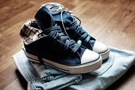 foto of denim jeans  - Fashionable denim female blue  sneakers and jeans - JPG