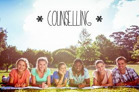 stock photo of counseling  - The word counselling against students studying outside on campus - JPG