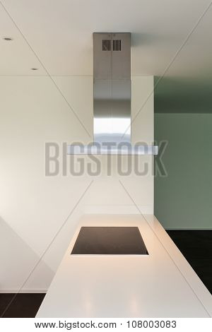 Interior of modern kitchen with induction hob, detail