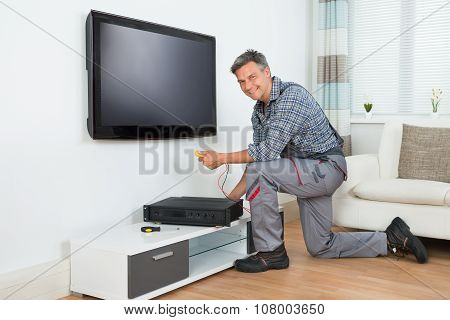 Technician Installing Tv Set Top Box At Home