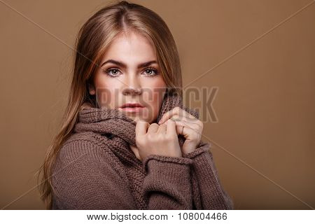 Girl Wrapped In A Warm Sweater.