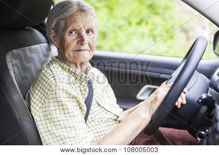 Senior woman driving a car.