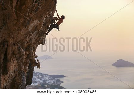 Male rock climber at sunset.