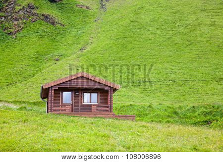 Wooden cottage at a mountain in Iceland
