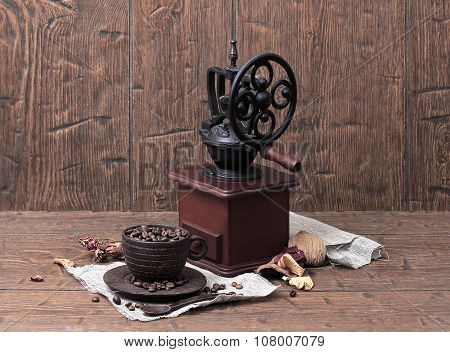 Vintage Coffee Grinder, Cup, Saucer, Spoon And Coffee Beans On Homespun Canvas