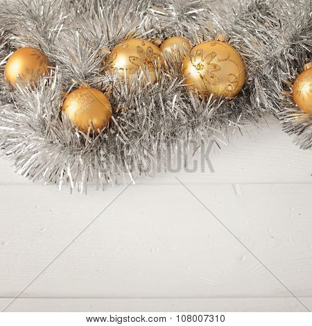 Christmas ornaments garland on wooden background