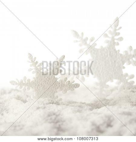 snowflake christmas ornaments and snow