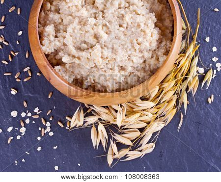 Oatmeal In A Wooden Bowl And Ears Of Corn Oat