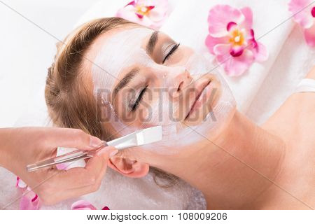 Beautician Applying Mask On Customer's Face At Salon