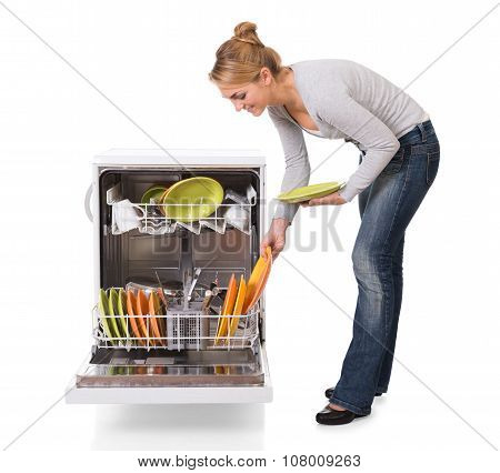 Woman Arranging Utensils In Dishwasher Over White Background