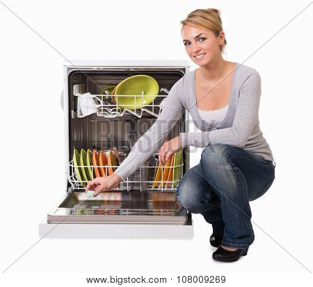 Young Woman Placing Soap In Dishwasher