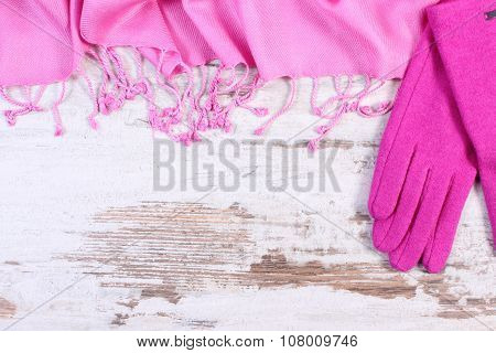 Woolen Gloves And Shawl With Copy Space For Text, Old Rustic Wooden Background