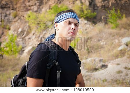 The Man In The Mountains With A Backpack