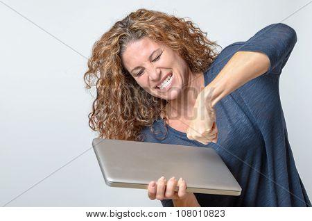 Woman Punching Her Laptop