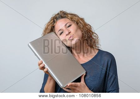 Woman Holding A Brand New Laptop