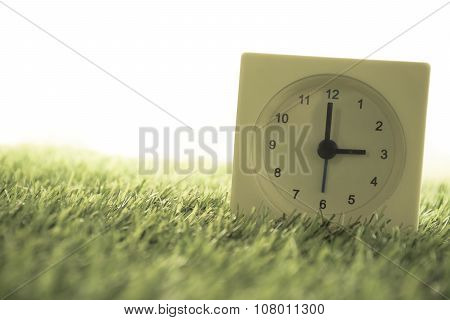 Time Is Three O'clock In The Evening, Clock On Artificial Green Grass. - Vintage Dream Filter