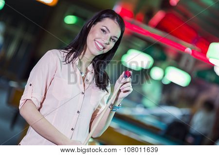 Young Beautiful Woman Chalking The Snooker Cue And Smiling