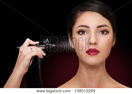 portrait of a beautiful girl with make-up  with airbrush.