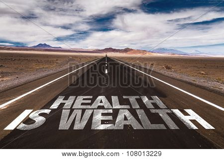 Health is Wealth written on desert road