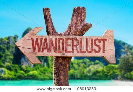 Wanderlust arrow with beach background