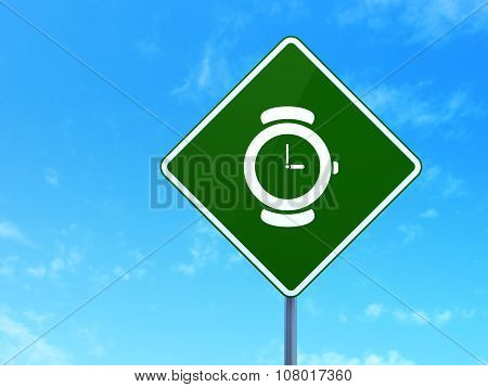 Time concept: Watch on road sign background