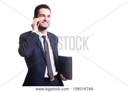 Happy Businessman Talking On The Phone With Folder In Hand