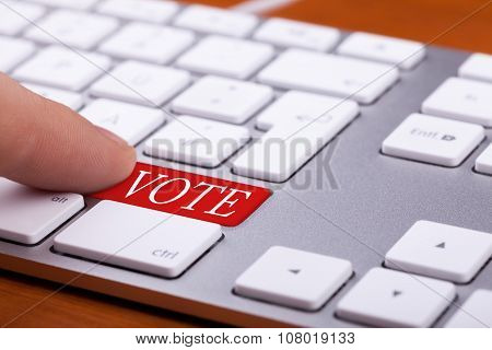 Finger Pressing On Vote Red Button On Keyboard