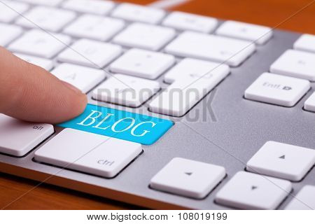 Finger Pressing On Blog Button On Keyboard