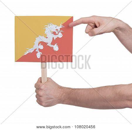 Hand Holding Small Card - Flag Of Bhutan