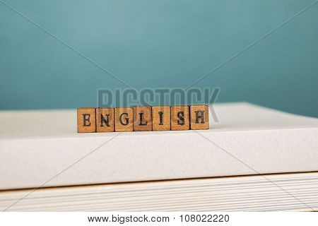 ENGLISH word written on wood block  background