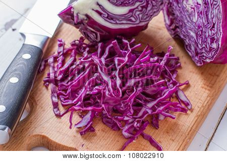 Sliced red cabbage on wood board