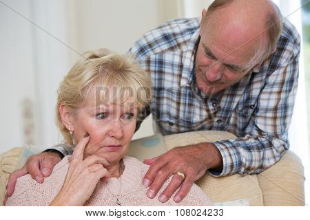 Man Comforting Senior Woman With Depression