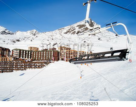 Chairlift In Mountains Under Snow