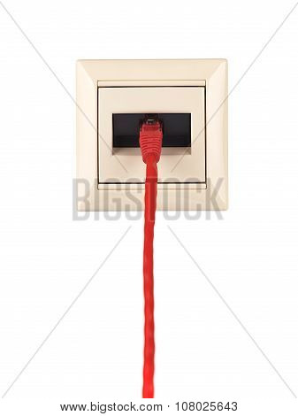 Cable with RJ-45 connector is connected to a wall outlet.