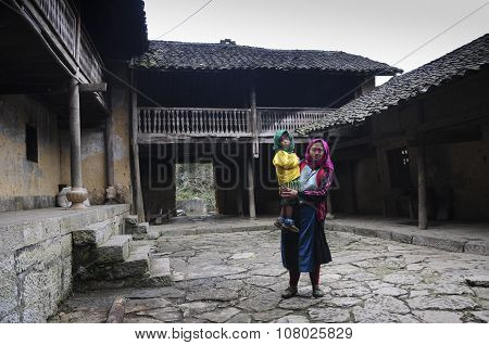 Hmong ethnic minority woman with her children in front of her house in Hagiang, Vietnam.