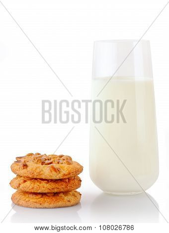 Stack of three homemade peanut butter cookies and glass of milk