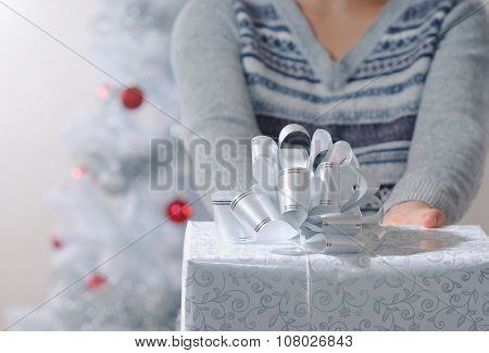 Cropped Shot Of Woman Giving You A Wrapped Christmas Gifts
